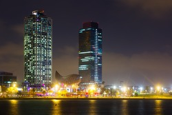 night view of skyscrapers fron sea - center of nightlife at Barcelona. Catalonia, Spain