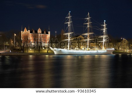 Night view of the Admiralty House and the af Chapman Ship in Stockholm, Sweden