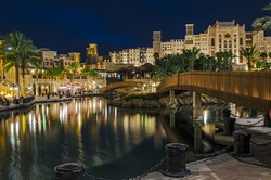 Night view of the artificial canal, Souk Madinat Jumeirah on the Arabian Gulf. Dubai, United Arab Emirates.