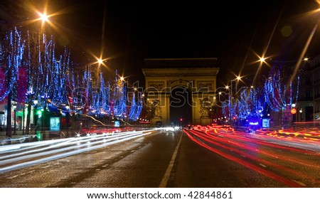 Night view of the Champs-Elysees with Christmas illumintation and the Arc de Triomphe in Paris, France