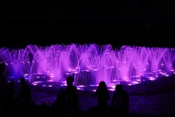 Night view of the ensemble of glowing fountains.