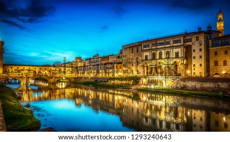 Night view of the famous bridge Ponte Vecchio and Gallery Uffizi on the river Arno in Florence, Italy.