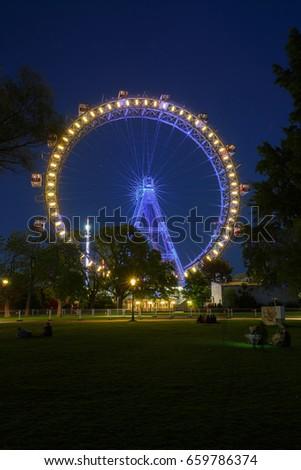 Night view of the illuminated Riesenrad ferris wheel in the Prater amusement park in Vienna, Austria Stock photo ©