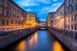 Night view of the Moika river and reflection in the water of illuminated buildings ,  in Saint Petersburg, Russia