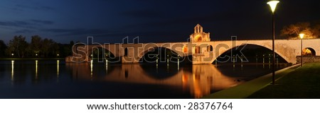 Night view of the Pont St. Benezet (AKA Pont d'Avignon) famous bridge in the town of Avignon, France (this is a panoramic photo made of multiple shots -> great res. - very suitable for large prints!)