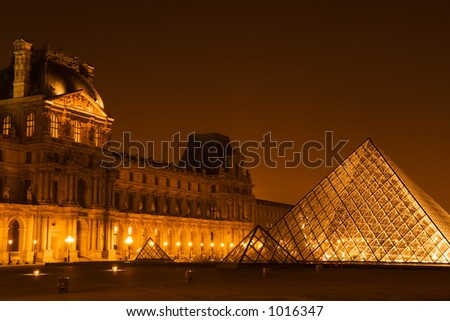Night view of the pyramid and Pavillon Denon at the Louvre museum - Paris, France