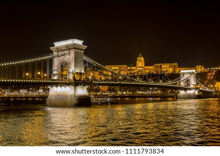 Night view of the Szechenyi Chain Bridge is a suspension bridge that spans the River Danube between Buda and Pest, the western and eastern sides of Budapest, the capital of Hungary #1111793834