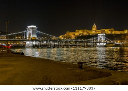 Night view of the Szechenyi Chain Bridge is a suspension bridge that spans the River Danube between Buda and Pest, the western and eastern sides of Budapest, the capital of Hungary #1111793837