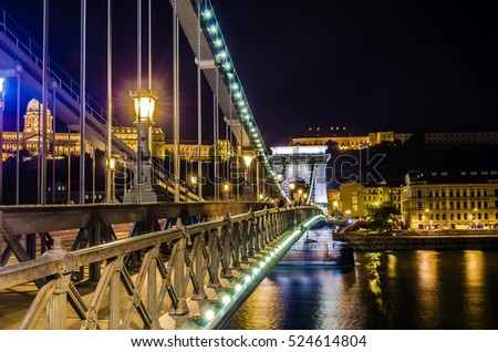 Night view of the Szechenyi Chain Bridge is a suspension bridge that spans the River Danube between Buda and Pest #524614804