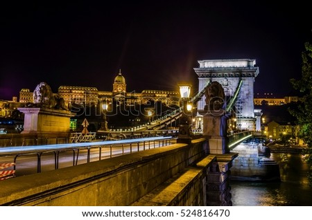 Night view of the Szechenyi Chain Bridge is a suspension bridge that spans the River Danube between Buda and Pest #524816470