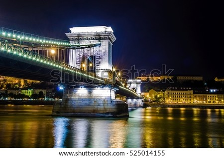 Night view of the Szechenyi Chain Bridge is a suspension bridge that spans the River Danube between Buda and Pest #525014155