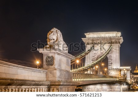Night view of the Szechenyi Chain Bridge is a suspension bridge that spans the River Danube between Buda and Pest, the western and eastern sides of Budapest, the capital of Hungary. #571621213