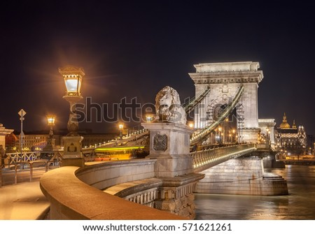 Night view of the Szechenyi Chain Bridge is a suspension bridge that spans the River Danube between Buda and Pest, the western and eastern sides of Budapest, the capital of Hungary. #571621261