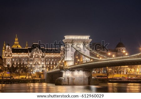 Night view of the Szechenyi Chain Bridge is a suspension bridge that spans the River Danube between Buda and Pest, the western and eastern sides of Budapest, the capital of Hungary. #612960029