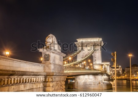 Night view of the Szechenyi Chain Bridge is a suspension bridge that spans the River Danube between Buda and Pest, the western and eastern sides of Budapest, the capital of Hungary. #612960047