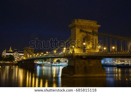 Night view of the Szechenyi Chain Bridge is a suspension bridge that spans the River Danube between Buda and Pest, the western and eastern sides of Budapest, the capital of Hungary. #685815118