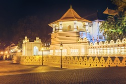 Night view of the Temple of the Buddha Tooth with lights. Kandy, Sri Lanka, Asia.