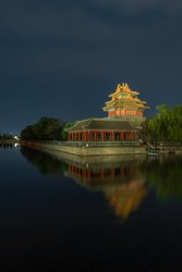 Night view of the Turret of Forbidden city in Beijing, China. The Forbidden City was the imperial capitol of ancient Chinese dynasties in central Beijing