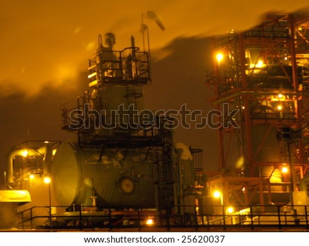 Night view of the vapors flowing over a petrochemical processing facility, 440 kms to the south of Fort McMurray's oil sands in Edmonton, Alberta.  The site lighting gave this photo its yellowish hue