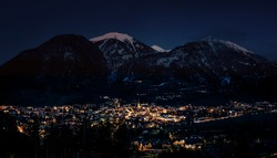 Night view of village in mountains during winter