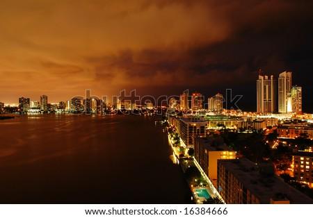Night view on Aventura from Sunny Isles Beach over Intercoastal Waterway