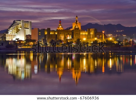 Night view on entertainment spots of Eilat city, Israel - stock photo