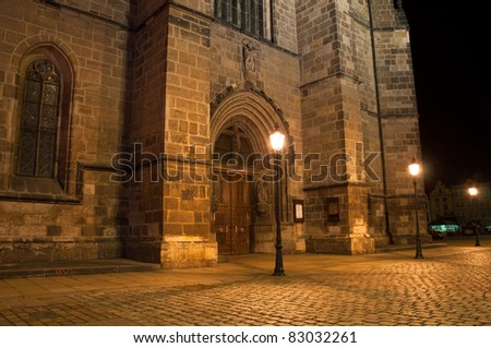 night view on main door of Gothic Cathedral of St. Bartholomew on Pilsen city square in Czech republic