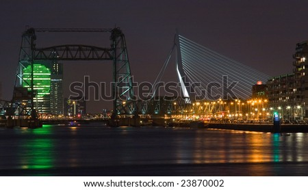 "Night view on Rotterdam with old lifting bridge ""Koningshavenbrug"" and new bridge Erasmusbridge with KPN building in background"