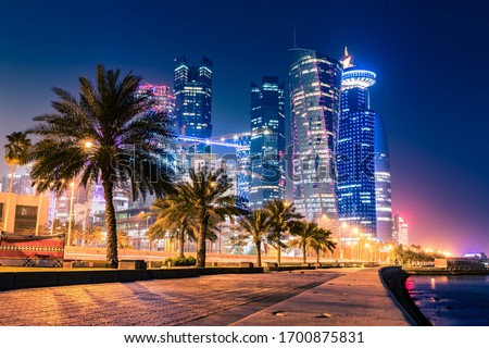 Night view on the centre of the city Doha, Qatar with many modern luxury building and skyscrapers illuminated with numerous lights. Stock fotó ©