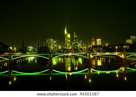 Night view on the Frankfurt skyline with reflections on water