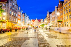 Night view on the illuminated market square in the old town center of Gdansk, Poland