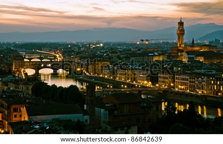 Night view over Florence, in Italywith  Palazzo vecchio, Ponte vecchio and Arno river