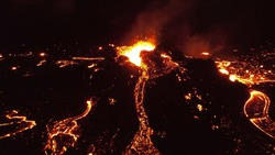 Night view over lava eruption volcano, Mount Fagradalsfjall, Iceland Hot lava and magma coming out of the crater, April 2021
