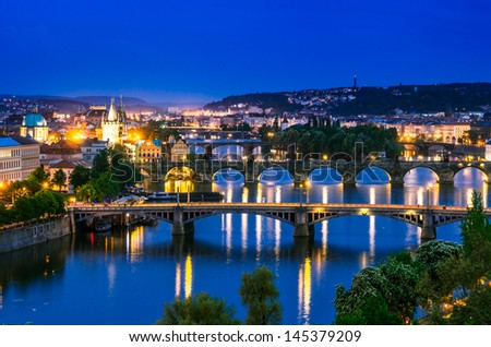 Night view over the Vltava river and bridges in Prague at sunset, Czech Republic