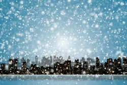 NIGHT VIEW SILHOUETTE OF NEW YORK / MANHATTAN WITH SNOW FALLING FROM DARK BLUE SKY