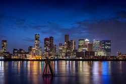 Night view to the illuminated skyline of the financial district Canary Wharf in London, United Kingdom