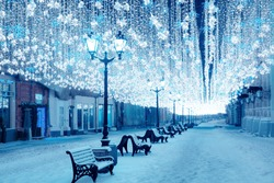 Night winter Moscow in the snow. Nikolskaya street decorated for the New year.