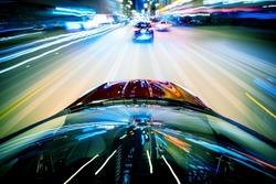 Nightly City Traffic Motion Blurs. Colorful Urban Illumination in Motion Blur. City Streets Speeding Car.