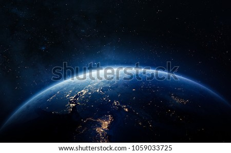 Nightly Earth in the outer space. Abstract wallpaper. City lights on planet. Civilization. Elements of this image furnished by NASA #1059033725
