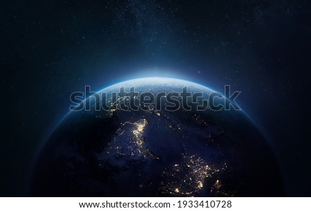 Nightly Earth planet in outer space. City lights on planet. Life of people. Solar system element. Elements of this image furnished by NASA