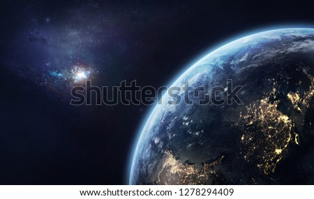 Nightly planet Earth before the dawn. Galaxy on the horizon. Civilization. Elements of this image furnished by NASA