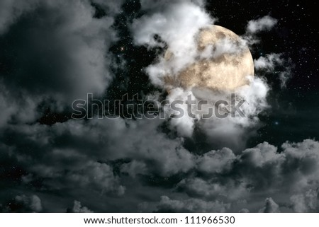 Nightly sky with large full moon, stars and beautiful clouds