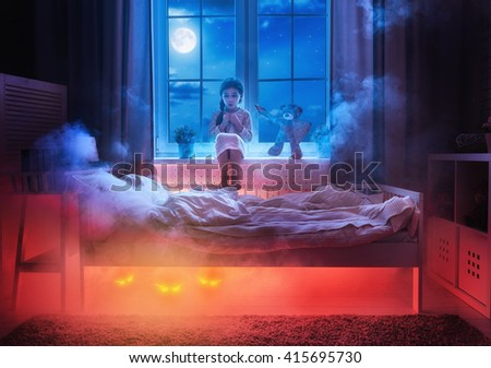 Stock Photo Nightmare for children. Little child girl is afraid of monsters in the dark of night. Frightened little girl and her teddy bear friend are protected against monsters.