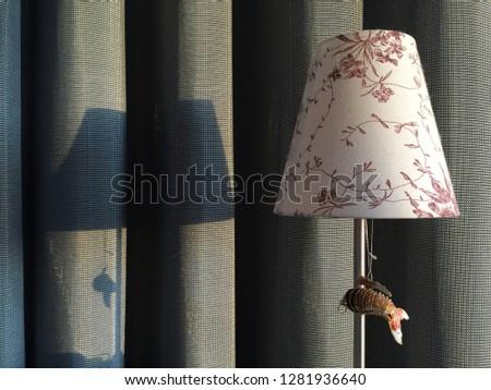 Nightstand lamp at sunset