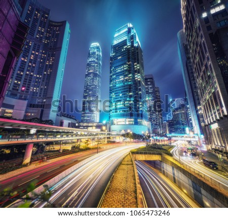 Nighttime cityscape of Hong Kong with skyscrapers and highways. Scenic travel background. #1065473246