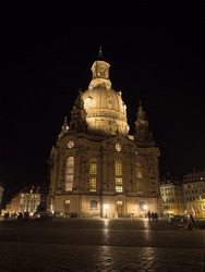 Nighttime panorama of baroque evangelical lutheran church of our lady Frauenkirche on Neumarkt main square Dresden Saxony Germany Europe