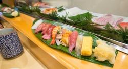 nigiri sushi at a sushi bar in Tsukiji fish market Tokyo Japan. beautiful tasty hand crafted sushi. bluefin tuna, otoro, chutoro, shrimp,mackerel, clam, yellow fin, lemon fish and tamago.