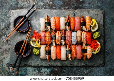 Nigiri Sushi set on gray stone slate on metal background