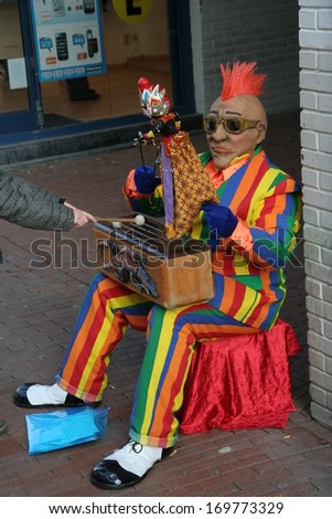 NIJMEGEN, THE NETHERLANDS - JANUARY 29 : Colored street performer playing a musical instrument on january 29, in Nijmegen, The Netherlands.
