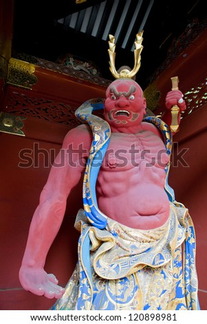NIKKO, JAPAN - NOV 11: Nio Benevolent Kings Sculpture in Nikko, Japan on November 11, 2012. Two wrath-filled, muscular guardians of Buddha who commonly stand guard outside the Japanese temple gate.